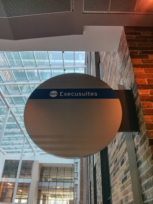 Execusuites. French for empty seats…